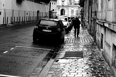 Without skis (pascalcolin1) Tags: reims homme man pluie rain reflets reflection batons stick voitures cars pavés pavement photoderue streetview urbanarte noiretblanc blackandwhite photopascalcolin canon50mm 50mm canon