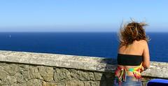 Enigma (alfonsocarlospalencia) Tags: enigma robado mujer viento cantabria santander faro horizonte azul líneas pensamiento velero negro colores luminosidad nordeste balcón piedra minimalismo mirada espalda
