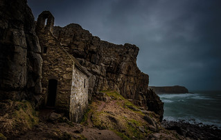 Moody view of St Govan's Chapel on a stormy day in Pembrokeshire