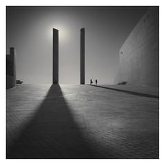 Behind the Shadow (Vesa Pihanurmi) Tags: architecture streetphotography shadow pillars champalimaudcentre lisbon lisboa portugal people charatcers fugures sun
