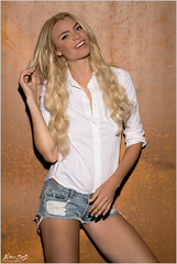 Miky: white Blouse and Shorts (Peter Heuts) Tags: miky bleiswijk peterheuts peter heuts photograph czech tjechisch milano milaan sony a99m2 a99ii a99mark2 fullframe carl zeiss carlzeiss sal135f18z 135mm f18 blonde blond smile lach smiling face gezicht gesicht closeup shorts hotpants jeans blouse bloes denim