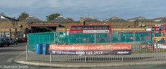 Work At The Garage (M C Smith) Tags: pentax k3 construction garage pottersbar hertfordshire bus buses red letters numbers symbols fencing bins blue sky clouds white trees green man hivi orange pavement kerb roadroller cars parking yellow
