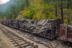 boxcar ruins - seen from the Durango & Silverton Narrow Gauge Railroad line, Colorado, USA 4 (Russell Scott Images) Tags: animasrivervalley sanjuannationalforest heritage durangosilvertonnarrowgaugerailroad colorado usa abandoned ruins rotting old boxcars goodswagons russellscottimages