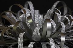 Sparkly Effervescence (Frogdaily) Tags: macromondays buttonsandbows bow macro sparkle gift ribbon sparkly christmas