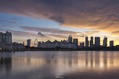 Sunset and the city (tapanuth) Tags: singapore cityscape building architecture reflection sunset marinabaysands twilight goldenhour bluehour water bay waterfront cloud burningsky city condo skyline beautiful travel tourism asia southeastasia financial business