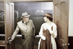 Brief Encounter - colour (f22photographie) Tags: timelineevent transport lighting reenactors museum steamswindon people nightphotography darkness railways station stationplatform stationwaitingroom hats shawl lace necklace smartlydressed gloves heritagemuseum steppingbackintime