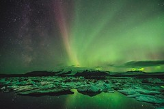 Northern lights over the ice lagoon, Iceland (altextravel) Tags: auroraicelandnorthernlightsborealislagoongreennatureicenorwayglacierastronomyjokulsarlonwinterspacenightbeautifulcoldsolarskylandscapesnowreflectionfjordswedenwaterlaplandbluelightreykjavikstars