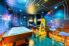 Pac Man (Awake at Night) Tags: longexposure gameroom arcade pacman airhockey interiordesign nikon d810 wideangle realestatephotography indoors abstract vacationrental blackhills deadwood fun
