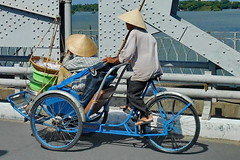 Rickshaw Express Delivery (gerard eder) Tags: world travel reise viajes asia southeastasia vietnam centralvietnam hue bridges brücken puentes bicycle rickshaw outdoor people peopleoftheworld paisajes landscape landschaft traffic