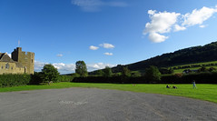 Stokesay Castle and car-park panorama (Dunnock_D) Tags: uk unitedkingdom britain england shropshire stokesay castle panorama carpark blue sky white clouds green grass trees hill children playing southtower tower
