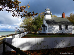 Old Mission Lighthouse (JamesEyeViewPhotography) Tags: old mission lighthouse lake michigan greatlakes autumn fall colors water waves clouds sky trees fence landscape lakemichigan northernmichigan nature storm jameseyeviewphotography