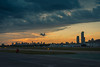 When the day takes off (Mariano Colombotto) Tags: buenosaires argentina airport aeropuerto sunrise airplane city skyline sky cielo travel clouds tones colours nikon photographer photography