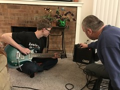 My son's birthday is today but he got a really awesome gift last night. (f l a m i n g o) Tags: son guitar birthday explore