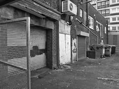 Rear (harrytaylor6) Tags: blackandwhite blackwhite monochrome shutters gate grey distopian urban realism bins refuse airconditioner