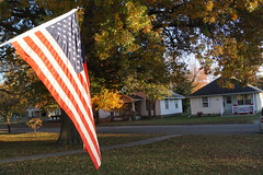 DSC02058 (tomcomjr) Tags: sonyilca77m2 sal1855 autumn fall trees leaves green red orange yellow gold kansas pittsburg sky blue grass brown american flag november 2017