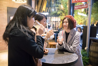Young women chatting at bar after work