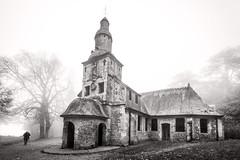 "a mourner walks past the chapel, La Chapelle Notre-Dame-de-Grâce in the cold mist, near Honfleur, Calvados, Normandy, France (grumpybaldprof) Tags: ""lachapellenotredamedegrâce"" ""côtedegrâce"" equemauville ""montjoli"" 1615 ""replacedpreviouschapelfoundedin1025"" church chapel chapelle mist fog brume brouillard mourner pleureuse walkingpast honfleur normandy normandie france calvados bw blackwhite ""blackwhite"" ""blackandwhite"" noireetblanc monochrome ""fineart"" striking artistic interpretation impressionist stylistic style contrast shadow dark black white canon 70d ""canon70d"" sigma 1020 1020mm f456 ""sigma1020mmf456dchsm"" ""wideangle"" ultrawide"