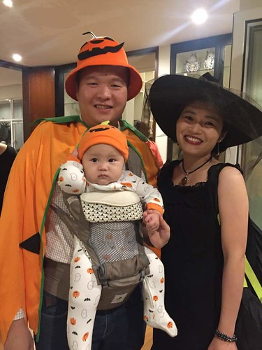 Grace, Aung, and baby James at a 2017 Halloween party