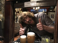 Great barman in Bitain's smallest pub in York city (keithericfoote) Tags: fun happy laugh smile man hatch hands thumbs thumbsup beard glasses waving smiling barman beer yorkshire york smallestpub pub people