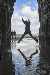 Leaping cathedral cave (Ian@NZFlickr) Tags: jumping tidal pool entrance cathedral caves and being admired by some young women from usa catlins otago nz silhouette