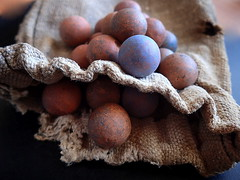 VINTAGE CLAY MARBLES..... (Lani Elliott) Tags: lanielliott vintage yesteryear marbles handmade handmademarbles claymarbles earthenwaremarbles c1880s hessianmarblebag macro upclose close closeup macrounlimited