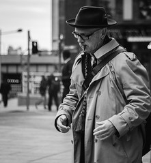 When cool guys hit the street (raymorgan4) Tags: pigtail smoker stmarystreet trilby cheroot cigar smoking earrings cardiff glasses wales street people urban coat canon eos 77d fashion trendy cool trench