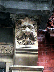 Horned Grimacing Gargoyle Creature Above Doorway 5031 (Brechtbug) Tags: horned gargoyle creature mask face with scrolls animal features west 21st street new york city 2010 satyr grimacing above doorway building facade 8th avenue nyc 09272010 midtown manhattan gargoyles portraits monster portrait monsters faces spooky art architecture sculpture keystone brownstone brown stone capital fall winter autumn creeped out goat