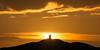 Hönö Huvud Lighthouse (diesmali) Tags: öckerö västragötalandslän sweden se hönö göteborg gothenburg island archipelago lighthouse sunset clouds sun cliffs black yellow orange canoneos6d canonef100400mmf4556lisiiusm