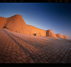 Wall (tsiklonaut) Tags: pentax 67 6x7 67ii film analog analogue analogica analoog 120 roll medium format slide dia positive e6 chrome fuji fujifilm provia 100f uzbekistan usbekistan wall fort fortress sunset mud architecture east central asia uzbek protection conquerer travel discover experience drum scan drumscan scanner pmt vivid color hiiva khiva old ancient city asian silk road civilization