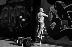 graffitiartist in action (wojofoto) Tags: amsterdam graffiti streetart artist action nederland netherland holland wojofoto wolfgangjosten zwartwit blackandwhite monochrome