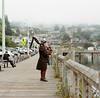 A Piper in Newport (Zane's Photography) Tags: hasselblad500cm portra400 kodak newport oregon bagpipes piper