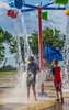 a splash back to buckets of summer fun (Pejasar) Tags: boy boys bixby oklahoma summer fun splash water buckets pour play splashpad grandsons color park