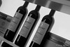 Weinprobe (Sockenhummel) Tags: 2017 berlin grünewoche masurenallee messe wein weinflaschen weinprobe schwarzweis blackwhite fuji x30 flaschen regal display wine bottles shop