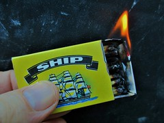 """Abandon Ship"" by Sean Walsh. (seanwalsh4) Tags: macromondays abandonship heldbetweenfingertips matchbox ship hot alight flame matchbox2incheslong fire firedownbelow ablaze smoke"