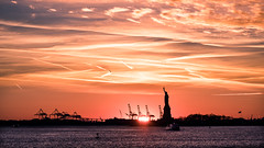 The Statue of Liberty at sunset - New York - Travel photography (Giuseppe Milo (www.pixael.com)) Tags: photo ferry newyork landscape manhattan landmark city cityscape liberty clouds silhouette statue travel photography evening architecture seascape sea sunset geotagged sky unitedstates us onsale