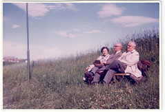 Three People (1966) (Fremdwortlexikon) Tags: sepia outside people sky meadow lamp woman man house clouds vintage foundphoto 1966 hat bench himmel wiese grass