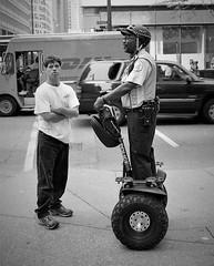 Chicago's Finest, Chicago (L55ZJNIT6B2KYV5V62Z4HAWSXZ) Tags: policeman segway monochrome zeissikon 35mm film street urban city blackandwhite