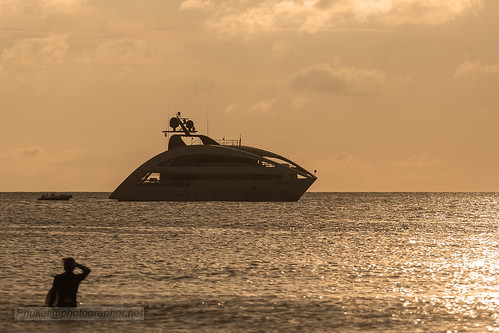 "Superyacht ""Ocean Emerald"" at sunset. Nai Harn beach, Phuket, Thailand"