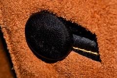 Black Leather Button (donjuanmon) Tags: donjuanmon theme macro macromondays hmm bowsandbuttons leather black brown
