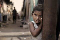 (silvia pasqual) Tags: india indian asia asian slum kolkata people portrait human child children everyday life daily reportage documentary photo photography picture travel traveling explore street canon eyes emotion travelling little beauty colors childhood