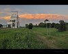 after storm (Gordon Hunter) Tags: bengough sk saskatchewan canada town village country prairies grain elevator tall building sunset warm glow thunder clouds storm grass sign tin sheet metal active inuse gordon hunter summer nikon d5000 june 26 2012