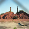(patrickjoust) Tags: tlr twin lens reflex 120 6x6 medium format film color manual focus analog mechanical patrick joust patrickjoust usa us united states north america estados unidos town mamiya c330 s sekor 80mm f28 kodak portra 160 c41 mill tractor dirt pile smoke stacks fence chain link danville va virginia