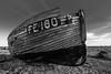 Dungeness, Kent, England. Boat Graveyard (Aethelweard) Tags: shepwaydistrict england unitedkingdom gb boat ship wreck beach coast coastline pebbles eerie beautiful blackandwhite old decaying decay sand canon scenery rural efs1018mmf4556isstm
