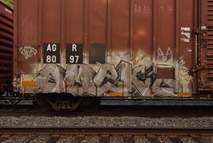 OMEKS (TheGraffitiHunters) Tags: graffiti graff spray paint street art colorful freight train tracks benching benched boxcar omek omeks