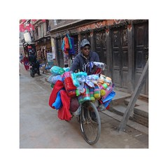 Kitchenware vendor (posterboy2007) Tags: nepal bicycle vendor kitchenware color nepali bhaktapur