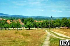 A path to the village. (travellor.cf) Tags: discover romania explore sky green nature village exploretheworld landscape landscapephotography fuji summer hills bluesky