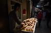 Jerusalem, 2017 (Antonio_Trogu) Tags: antoniotrogu streetphotography street urban candid 2017 ricohgr2 ricohgrii ricohgr jerusalem oldtown souk suq market bread seller baker arab quarter