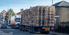 Pallet Load (M C Smith) Tags: pallet pallets truck pentax k3 numbers letters buildings traffic car pavement railings black orange red green hedges powerlines sky blue trees clouds white lines trucks arrow lamps aerial