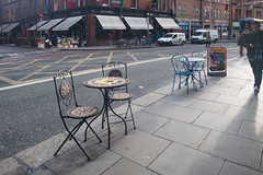 STORING THEIR WARES ON THE FOOTPATH [DISPLAYING AND SELLING GARDEN FURNITURE IN THIS WAY IS ANNOYING AND TOTALLY UNACCEPTABLE]-133996 (infomatique) Tags: georgesstreet dublin clutteredfootpath unacceptable annoying streetsofdublin hardwareshop williammurphy infomatique fotonique outdoorfurniture