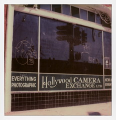 A Hollywood Sign 164 (tobysx70) Tags: the impossible project tip polaroid sx70sonar sonar instant color film for sx70 type cameras impossaroid a hollywood sign 164 camera exchange ltd blvd boulevard east los feliz angeles la california ca shop store closed everything photographic graffiti tag marilyn monroe poster window reflection traffic light toby hancock photography